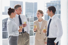 Group of cheerful business people clinking their flutes of champ Royalty Free Stock Photography