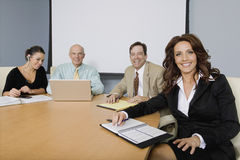 Group of Cheerful Businesspeople In Meeting Stock Images