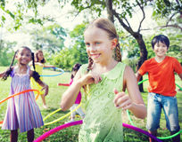 Group Cheerful Children Playing Hulahoop Concept Stock Photography