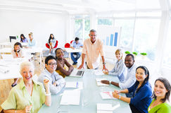 Group of Cheerful Corporate People Having their Meeting Royalty Free Stock Images