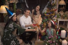 Group of cheerful friends celebrate Christmas and New Year together give a toast. With champagne Stock Images