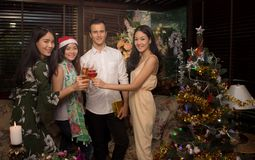 Group of cheerful friends celebrate Christmas and New Year together give a toast. With champagne Royalty Free Stock Photo