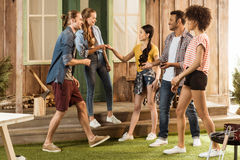 Group of cheerful friends gesturing and having fun together stock images