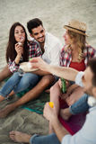 Group of cheerful friends having great time at beach Royalty Free Stock Image