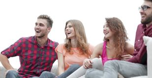 Group of cheerful friends sitting on the couch. In the living room stock images