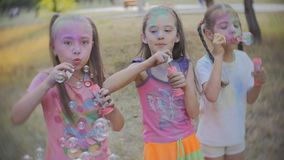 Group of cheerful girls in the yard playing with soap bubbles stock video footage