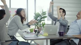 Group of cheerful happy Asian creative business women and men enjoy and having fun dancing while working in her office. Group of casually dressed business stock video
