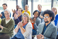 Group of Cheerful People Applauding with Gladness Royalty Free Stock Photos