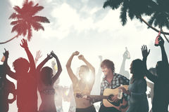Group of Cheerful People Partying on a Beach.  stock photography
