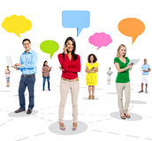 Group of Cheerful People Using Digital Devices with Speech Bubbles Royalty Free Stock Images