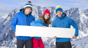 Group of cheerful snowboarders Royalty Free Stock Photo