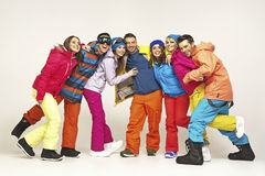 Group of cheerful snowboarders friends Royalty Free Stock Photography