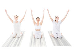 Group of cheerful women practicing yoga on yoga mats royalty free stock photos