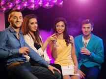 Group of cheerful young friends at night club Royalty Free Stock Photos