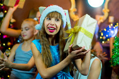 Group of cheerful young girls celebrating Christmas. Gifts Stock Photo