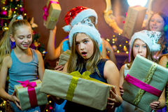 Group of cheerful young girls celebrating Christmas. Gifts Stock Photos