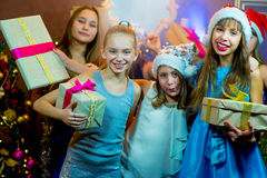 Group of cheerful young girls celebrating Christmas. Gifts Stock Photography