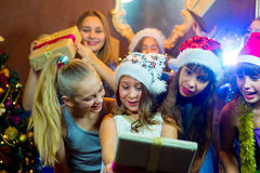 Group of cheerful young girls celebrating Christmas. Gifts Stock Image