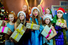 Group of cheerful young girls celebrating Christmas. Gifts Royalty Free Stock Photography