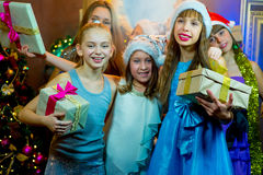Group of cheerful young girls celebrating Christmas. Gifts Royalty Free Stock Photos