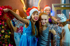 Group of cheerful young girls celebrating Christmas Royalty Free Stock Image
