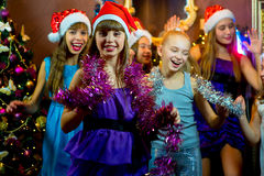 Group of cheerful young girls celebrating Christmas Royalty Free Stock Photos