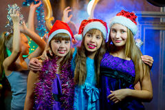 Group of cheerful young girls celebrating Christmas Stock Image