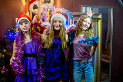 Group of cheerful young girls celebrating Christmas Stock Photo