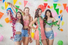 Group of cheerful young people celebrating together over New yea