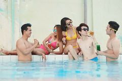 Friends at swimming pool stock photo