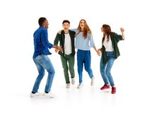 Group of cheerful young people men and women isolated on white background royalty free stock photography