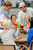 Group of cheerful people toasting with cocktails Stock Images