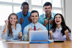 Group of cheering latin and african american and caucasian businesspeople. At office stock photos