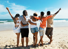 Group of cheering young adults at beach. Outdoor in the summer stock photography