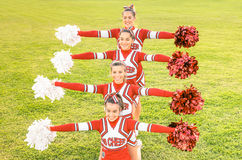 Group of cheerleaders in action with female coach Stock Image
