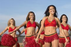 Group Of Cheerleaders Cheering Together Stock Image