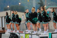 Cheerleaders at high school football game. A group of cheerleaders doing their routine at a high school football game royalty free stock photo