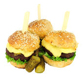 Group Of Cheeseburger Sliders. With melted cheese isolated on a white background Stock Photo