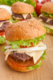 Group of cheeseburgers, with ingredients Stock Image