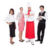 Group of chef and waiters. Group of restaurant chef and waiters. Isolated on white Royalty Free Stock Photo