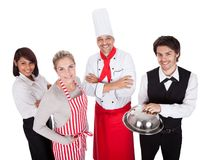 Group of chef and waiters. Group of restaurant chef and waiters. Isolated on white Royalty Free Stock Images
