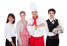 Group of chef and waiters Stock Images
