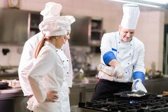 A group of chefs preparing delicious meal in high luxury restaurant. royalty free stock images