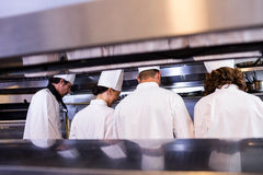 Group of chefs in white uniform busy to preparing food Royalty Free Stock Photography