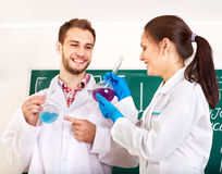 Group chemistry student with flask. Royalty Free Stock Photo