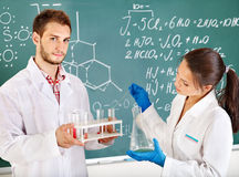 Group chemistry student with flask. Royalty Free Stock Images