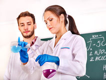 Group chemistry student with flask. Stock Photos
