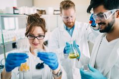 Group of chemistry students working in laboratory Stock Photo