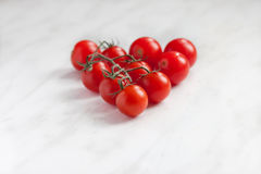 Group of cherry tomatoes. On white table Stock Image