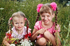 Group of child girl in green grass. Royalty Free Stock Images